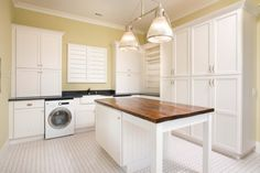 Spacious laundry room with large folding island.  #laundryrooms homechanneltv.com
