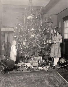 Vintage Christmas Photographs ~ Girl and Boy on Christmas Morning. Circa early 1900's.