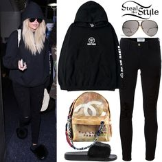 Khloe Kardahsian was spotted arriving at LAX last week wearing a Kanye West Saint Pablo World Tour Hoodie (Not available online), Frame Distressed Skiny Jeans ($284.45), Chanel Graffiti Backpack (Sold Out), Porsche Design by Carrera 5621 Sunglasses ($229.00 – preowned) and Givenchy Mink Fur & Rubber Slides ($595.00). You can find similar slides for less at PrettyLittleThing ($35.00).