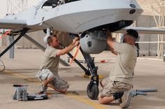 Danger Zone: Air Force mechanics and technicians replace a Multispectural Targeting System Ball on a Predator MQ-1B drone in Iraq, July 2008. (Photo: U.S. Air Force)