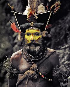 Huli tribesman. It is believed that the first Papua New Guineans migrated to the island over 45000 years ago. Today, over 3 million people, half of the heterogeneous population, live in the highlands. Some of these communities have engaged in low-scale tribal conflict with their neighbours for millennia.