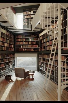 Contemporary Library with Hardwood floors, Built-in bookshelf, Loft, picture window, High ceiling