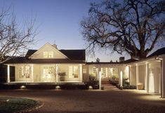 Elements of this house remind me of a B&B very special to us.  Crushed gravel drive, well placed landscape lighting, exterior columns and covered porch areas makes you feel welcome to stroll, feel at home instantly.