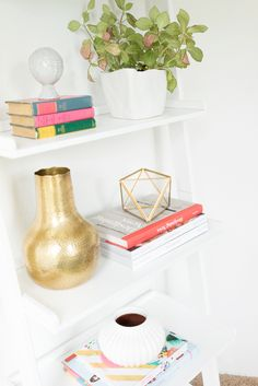 Rifle Paper Co.'s Office // White bookshelves, succulents, and vases