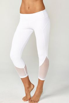 Our BEST SELLING essential capri. A sleek fashion-forward cropped legging with mesh insets at hips and calves. Comfortable second skin like fabric. Mid-rise, figure contouring waistband.