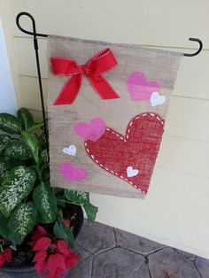 "Burlap Valentine's Day yard flags for the home porch or garden.. $16 includes shipping  Find me on Facebook at  ""Leow ON Duty"" for placing orders!!"