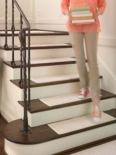 "Vista Stair Treads (set of 4) $29.98 ♦ All you have to do is lay these stair treads in place to prevent scratches and wear from damaging your wood steps. Nonslip backing lets you put these pure cotton stair treads in place so you can lift them for machine washing. Each stair tread is approx. 9"" x 29"". Use carpet nails or glue for permanent installation. 100% cotton"