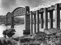 Royal Albert Bridge, Saltash, Cornwall. This bowstring tubular plate girder railway bridge over the River Tamar connects Devonport in Devon to Saltash in Cornwall. Built by the engineer I K Brunel, work began on the bridge in 1848 and was completed in 1859. Photographed by Eric de Mare in 1954 with a goods train steaming across the bridge.