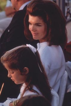 The First Lady sits next to her daughter, Caroline Kennedy, at a dedication ceremony to the late US president John F Kennedy, 1968