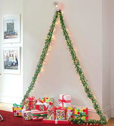 These alternative Christmas tree ideas are a great way to make your home stand out from all of your friends and family. They're fun and easy to make too! Wall Hanging Christmas Tree, Diy Christmas Tree, Modern Christmas, All Things Christmas, Christmas Tree Decorations, Christmas Holidays, Christmas Lights, Xmas Trees, Simple Christmas