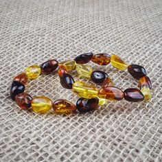 Large bean style natural baltic amber bracelet. Hand made by Lithuanian artisans! On sale at our etsy shop !!