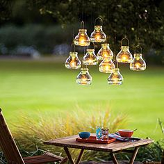 DIY: use mini recycled glass tea light lanterns or mini mason jars and wire to create this romantic look