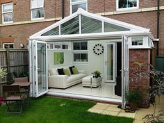 Guide to Conservatory Prices: How Much Does a Conservatory Cost? Conservatory Dining Room, Modern Conservatory, Conservatory Interiors Small, Conservatory Ideas Interior Decor, Conservatory Ideas Sunroom, Orangery Conservatory, Sunroom Ideas, Orangerie Extension, Patio Ideas
