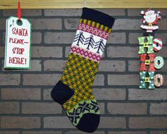 Hang this charming Christmas stocking by the fireplace this year! The Purple trees and snowflakes add an extra touch of holiday cheer to this stocking. The cuff, heel and toe I knit in Navy Blue and I also featured a Green and Gold plaid design on the leg of this stocking. This stocking will add a charming, homespun feel to your holiday decor  FREE Personalization!! Your stocking can be personalized on the cuff. For best results no more than 6 - 7 letter names please (**Longer Names May Wrap…