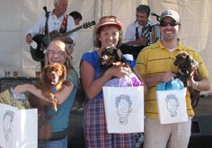 The 2009 Dachshund Race winners, left to right, were Buddy, Tucker, and Ginger with their humans.