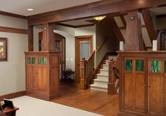 A beautiful Craftsman entrance hall with stained glass.