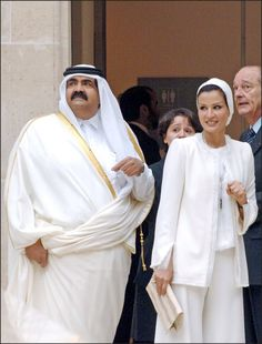 Sheikha Mozah in classic white couture suit seems like from Chanel. Chic and sophisticated.
