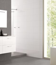 White bathroom tiles are a classic choice that create clean, simple lines. Shown here: Canada Blanco