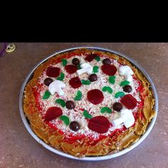 Pizza cake. Dyed frosting red. Used fruit rollups for pepperoni, milk duds for sausages, gummies for peppers, marshmallows for mushrooms, shredded white chocolate for cheese. Made a chocolate cake and used buttercream frosting dyed yellow for crust. otherwise can use yellow cake and not have to make the crust. super easy!