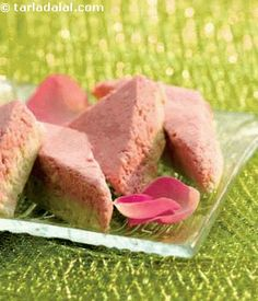 Rose Barfi ADD ROSE SHERBET WITH ROSE COLOUR ngredients cup crumbled low fat paneer (cottage cheese) 3 tbsp crumbled low fat mava (khoya) 2 tbsp powdered sugar a few drops of rose essence 2 to 3 drops of red colour Other ingredients tsp ghee for greasing Indian Veg Recipes, Indian Desserts, Indian Sweets, Bangladeshi Food, Sweets Recipes, Healthy Recipes, Classic Cake, Dessert Drinks, Vegan Treats