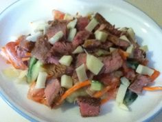 Ingredients  4 oz cooked steak, cut into strips  1 medium sized tomato, cubed  1/2 English Cucumber, cubed  1/4 cup grated carrots  1 oz reduced-fat mozzarella cheese, cubed  3 tbsp. fat-free Miracle Whip  2 tbsp. Sweet Onion salad dressing