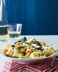 Spring Pasta with Blistered Cherry Tomatoes   Mario Batali's outstanding vegetable pasta boasts juicy roasted tomatoes with asparagus, Broccolini and shavings of ricotta salata cheese.