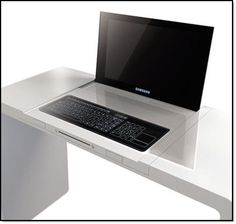 a laptop built into your desk way cool i would totally get it!