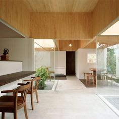 Tablehat by Hiroyuki Shinozaki. Deep timber ceiling recesses used as space ordering element