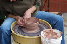 Local potter in Montpellier enjoying sun while spinning clay bowls