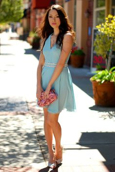 pastel blue dress with floral clutch