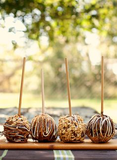 Peanut Butter-Stuffed Gourmet Caramel Apples.  Stuff pb mixture where the core used to be.