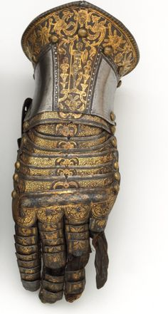 Pair of Gauntlets. Ca. 1585. Steel, gold, silver, leather. Italian (Milan)