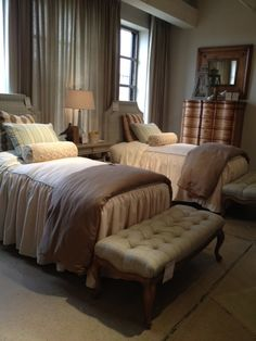 Note the twin beds with benches at end.  Love the bedspreads, and striped pillows.