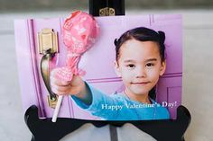 take photo with closed hand outstretched - add some cute writing, print photo - cut slit at top and bottom of fist, insert sucker (tape it in back) and you have a really cute and personalized Valentine.