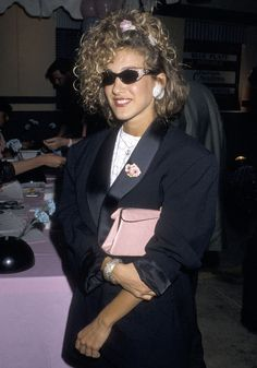 Before SJP became a style icon, she was pretty lost. And lastly, when she wore this perfect '80s outfit. Bedazzled sunglasses, oversized tux jacket, peace necklace, and hair tie that perfectly held together a sideways ponytail.