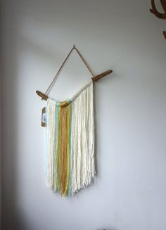 """Learn more about ** Driftwood yarn wall hanging / """"Waterfall"""" / textile wall artwork / nursery decor / Mint gold cream fringe"""