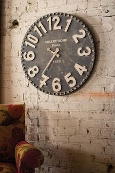 """Black and White Wooden Wall Clock-Farmhouse bliss. You will love the pop of white against this gorgeous black clock. Sure to delight in any farmhouse.Black and White Wooden Wall Clock measures 28""""______________________________"""