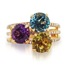 Rosendorff amethyst, blue topaz and lemon quartz ring crafted in 18 carat yellow gold featuring claw set round brilliant diamond in a triple split band…
