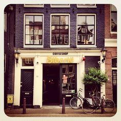 Amsterdam  #bikesinthecity #coffeeshop #canal #ubiquography #bike #holland #igersholland #jj_forum #amsterdam #dutch - @alanisko- #webstagram