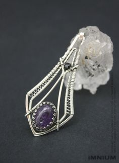 Amethyst pendant bezel set amethyst in a wire wrapped by IMNIUM
