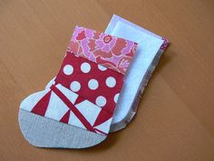 Jenny: Scrappy Stocking Christmas Ornament  ~ Good way to use up old scraps of fabric.