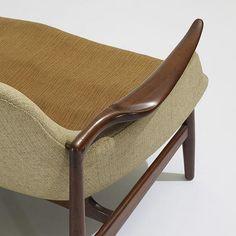 Finn Juhl settee, model NV-53   Niels Vodder   Denmark, 1953   teak, brass, upholstery   51 w x 31 d x 29 h inches   Signed with impressed manufacturer's mark to underside: [Denmark].