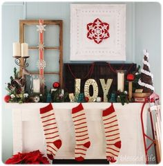Love his vintage Christmas mantel