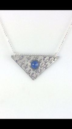 Triangle love necklace made out of 18 gauge Sterling silver sheet metal. 8mm denim lapis stone set in an argentium 935 silver crown bezel.