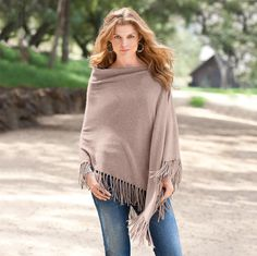 "Luxe with a live-and-let-live ease, this cloud-soft cashmere poncho falls at a slant. Our neutral colors go with everything—fortunate, as you'll want to wear it everywhere. Hand fringed. Hand wash. Imported. One size. Approx. 32"" at longest point."