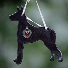 Here's the perfect gift for your Dane-loving friends, or a wonderful addition to your own home. This ornament is lovingly handcrafted of white porcelain, and then fired with an eggnog-toned glaze. Hanging inside the heart cut-out is a genuine Swarovski Crystal. It all hangs from a lovely satin ribbon, and measures approx. 5 inches long and 3 inches wide. Handmade item in the USA.