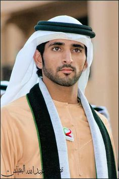 "Sheikh Hamdan (or Sheikh YamYam? ;-) Ladies of the European Union, look East! This is Sheikh Hamdan bin Mohammed bin Rashid al Maktoum also known as ""Fazza,"" the name under which he publishes his poetry, (born 13 November 1982), is the Crown Prince of Dubai and the 'Brad Pitt (in my opinion Fazza is muuuuuchh better looking) of the Middle East'."