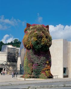 """Puppy, 1992. Jeff Koons. Koons rose to prominence in the mid-1980s as part of a generation of artists who explored the meaning of art in a media-saturated era and the attendant crisis of representation. With his stated artistic intention to """"communicate with the masses,"""" Koons draws from the visual language of advertising, marketing, and the entertainment industry."""