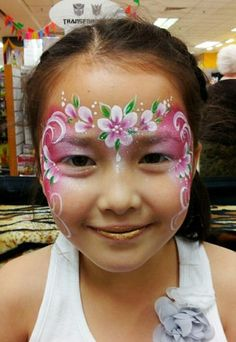 Rainbow cake, swirls and flowers for quick face painting.