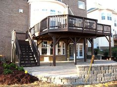 Elevated Deck Designs | Elevated composite deck creating covered patio area - Composite and ...